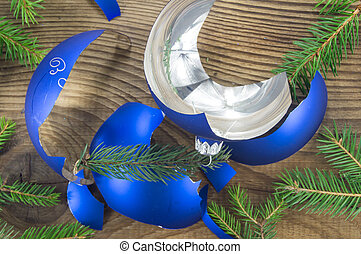 Broken Christmas Toy on wooden background