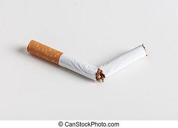broken cigarette quit smoking on a light background