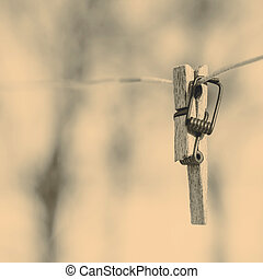 Broken clothespin on the wire, focus on the foreground