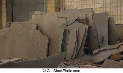 Broken concrete ruins abandoned plant indoors