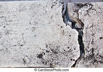 concrete barrier between home had broken.
