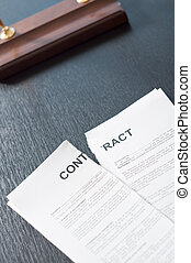Broken Contract - Terminate the contract on a black table...