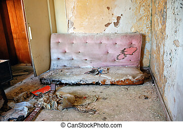 broken couch - Broken couch and peeling paint wall. ...