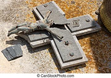 Broken cross and Jesus statue