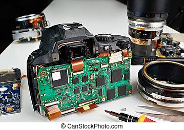 Broken digital SLR camera in repair on service center