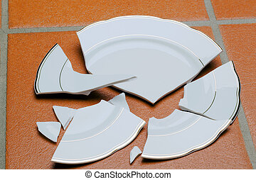 Broken dish - A broken dish is on the floor in the kitchen