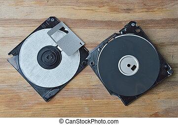broken diskette on wooden board