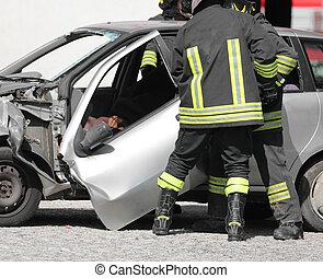 broken door of car after accident and firemen