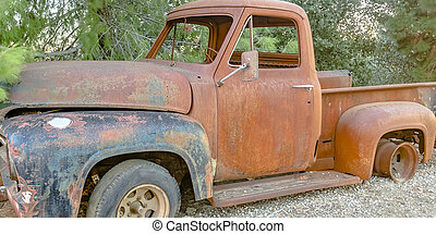 Broken down pickup truck in the forest