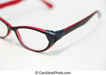 Broken Eyeglasses on White Background