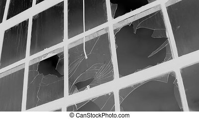 Broken factory window. Inverted. - A large window at an...
