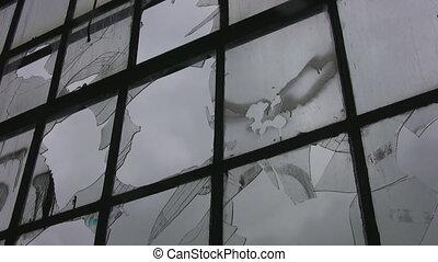 Broken factory window. Timelapse.