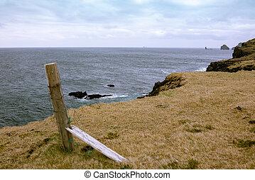 Broken fence on Heimaey