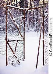 Broken fence under snow