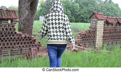 broken fence woman rain