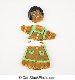 Broken gingerbread cookie.
