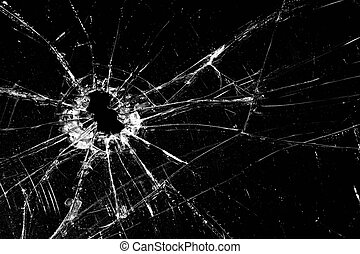 broken glass - cracked with hole over black