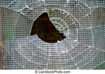 Broken glass in the window of industrial warehouse