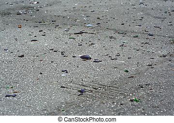 Broken glass on asphalt