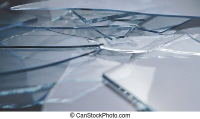 Broken glass turns on a stand. Close up - Broken glass turns...
