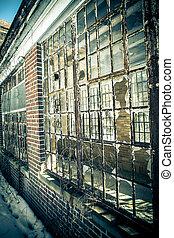 Broken glass windows from abandoned hospital