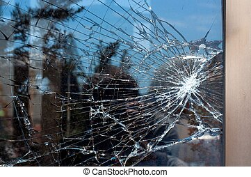 Broken Glass with outdoor street reflection. Closeup.