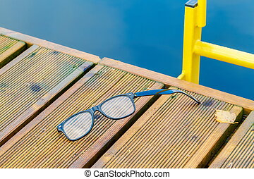 Broken glasses on edge of the pier. Life safety concept