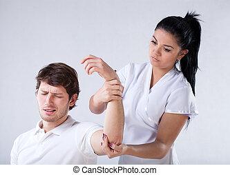 Broken hand examining
