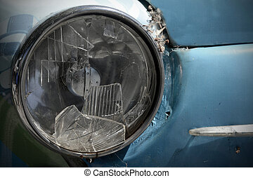 Old car with a broken headlight
