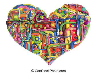 Broken heart concept - Broken damaged heart isolated clay...