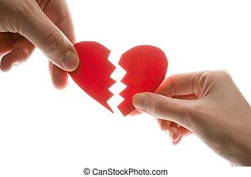 Broken heart - Female and man's hands with broken heart