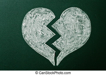 Broken heart on green blackboard