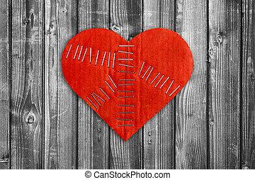 Broken heart on wooden background