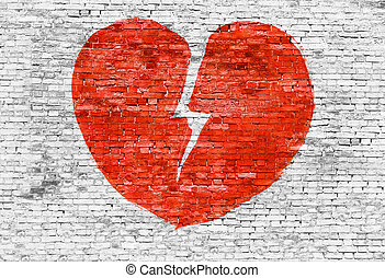 Broken heart painted on brick wall