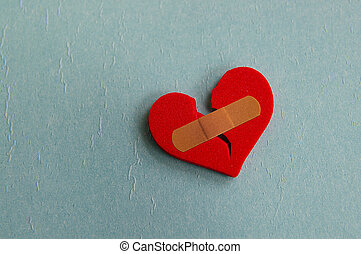 broken heart with a bandage, on blue