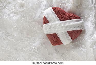 Broken Heart With Gauze Bandage - Broken heart concept of a...