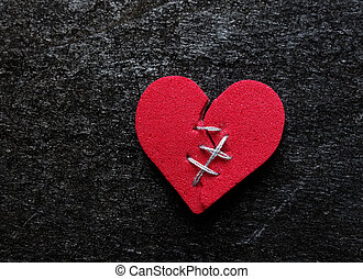 Broken hearted - Red broken heart with thread stitches on ...