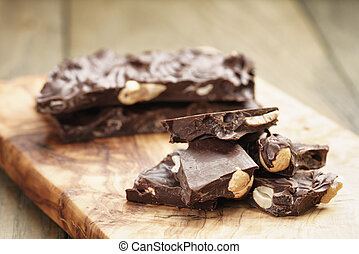 broken homemade bar of chocolate with cashew nuts reverse ...