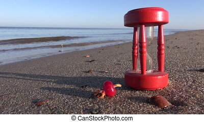 broken hourglass sandglass beach