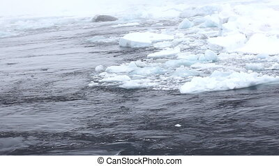 Broken ice of Arctic ocean aboard the icebreaker.