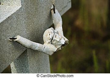 Broken Icon - Broken figure of jesus Christ on a grave...