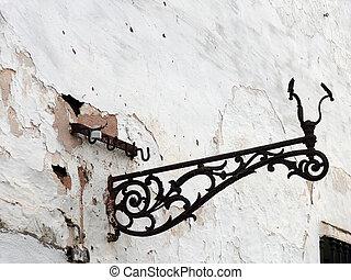 lamp holder - broken lamp holder on an old wall