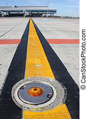 Broken light on taxiway - Detailed view of broken light on...