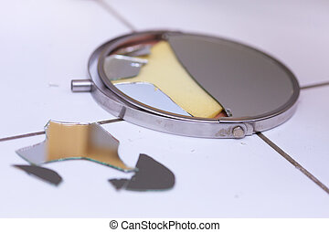 Broken mirror lying on ground