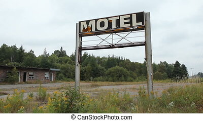 Broken Motel sign and wrecked motel