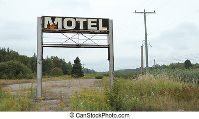 Broken Motel sign. Wide angle. - Large, broken motel sign by...