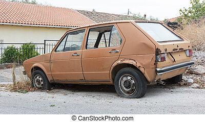 Broken old car at the side of a Greek road