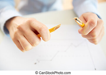 Broken pencil - Stressed business worker releasing tension...