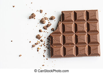 Broken piece of chocolate with crumbs on a white background. Cocoa Dessert