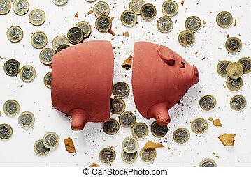 broken piggy bank and euro coins